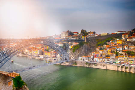 Porto Cityscape on the Douro River and Dom Luis I Bridge at Sunset. Horizontal image Orientation