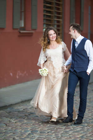 Portrait of Happy Caucasian Wedding Couple Having a Stroll Together.Vertical image