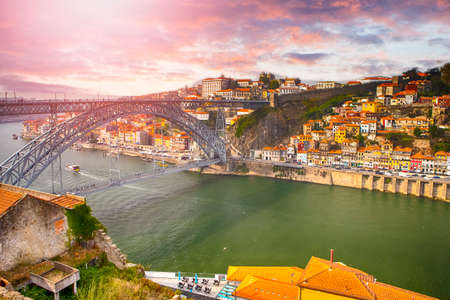 Porto Cityscape on the Douro River and Dom Luis I Bridge at Sunset. Horizontal image Composition