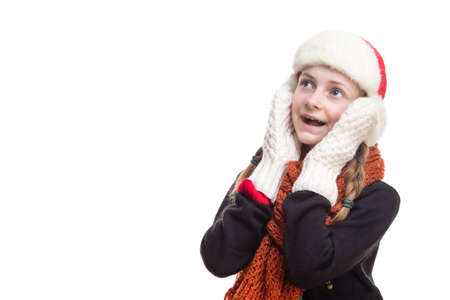 Suprised Caucasian Girl With Pigtails Posing in Winter Outfit Against Pure White in Studio. Looking Upwards. Horizontal Image