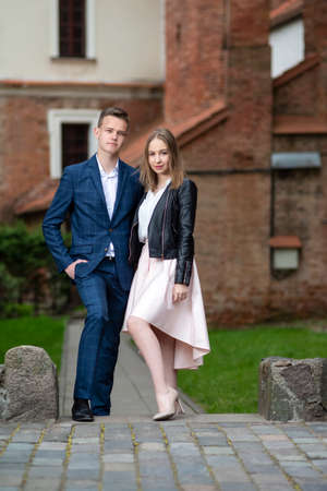Portrait of Fashionable and Elegant Caucasian Couple Together Outdoors.Vertical image Фото со стока