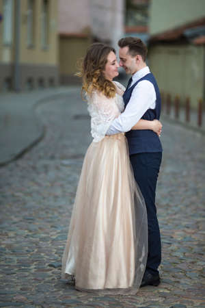 Portrait of Happy Caucasian Wedding couple Together Embracing.Vertical image
