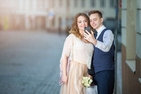 Happy Romantic Just Married Caucasian Couple Making Selfie Outdoors in City. Horizontal Image