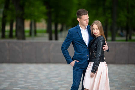 Sensual Portrait of Young Tranquil Couple in Love Embracing Outdoors in Park. Horizontal Image