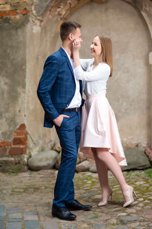 Happy Caucasian Couple Posing Embraced Together Outdoors. Vertical Image