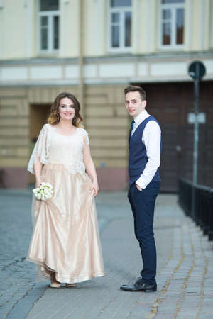 Happy Just Married Couple Having a Stroll Outdoors. Vertical Image