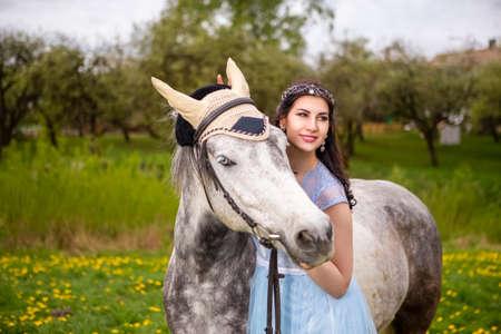 Portrait of Blond With Horse Outdoors. Horizontal Image Reklamní fotografie
