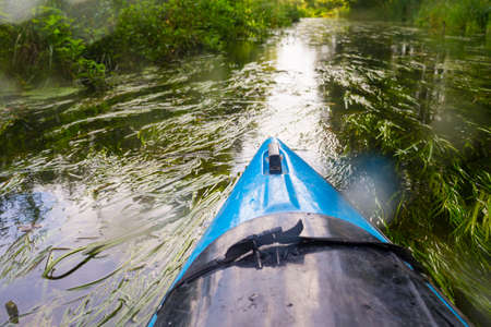 Travel and Vacation Ideas. Prow of Kayak On River Outdoors During Summertime. Horizontal Image