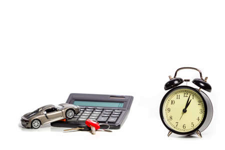 Scale Car With Keys OnForeground and Calculator as Credit Illustration. With Added Clock as Time Marker. Horizontal Image Stockfoto