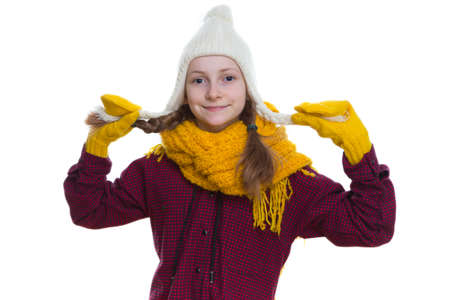 Winter Kids Concepts. Portrait of Smiling Positive Caucasian Girl Posing in Winter Outfit With Pigtails Against White in Studio.Horizontal  Image Orientation Stock fotó
