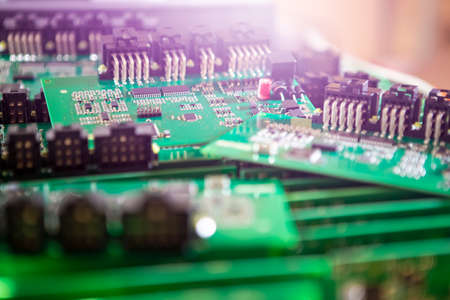 Variety of Just Produced Automotive Printed Circuit Boards with Surface Mounted Components with PCBs On Top of Boards. Shallow DOF.  Horizontal Shot