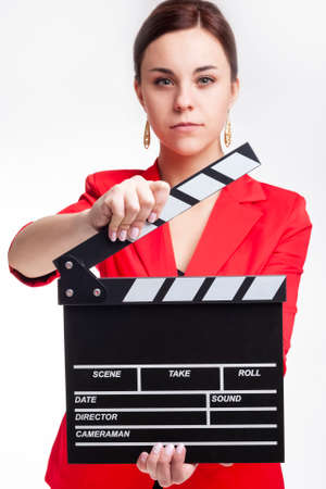 Caucasian Female Posing in Red Blazer with Actioncut Indoors. Focus on Actioncut.Vertical Image
