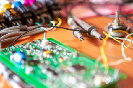 Electronics Ideas. Automotive Printed Circuit Board with Surface Mounted Components and Connected Wire Probes During a Process of Tesing  in Laboratory. Horizontal Image Banco de Imagens - 137163176