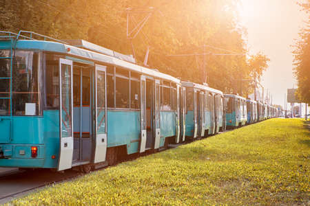Public Transport Accidents. Line of Tramways Stuck in City Jam at Daytime. Horizontal Image Stock Photo