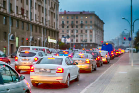 Cars Traffic Jam in The City With Lines of Blurred Cars Waiting for Green Light.Horizontal Image