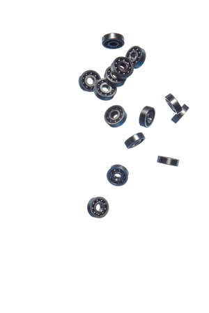 Large Amount of Ball Bearings Shaped and Formed In Free Fall Bulk. Isolated Over White Background. Vertical Image Orientation