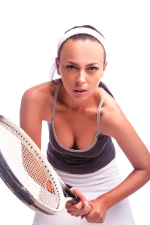 Portrait of Sexy Female Tennis Player in Sport Outfit Posing With Racket Against White. Vertical Image