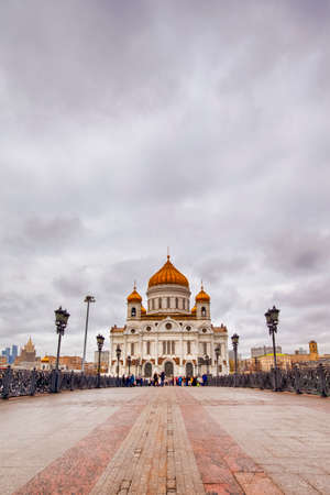 Cathedral of Christ the Saviour With View From Bridge Across The Moskva River With Tourists. Vertical Image