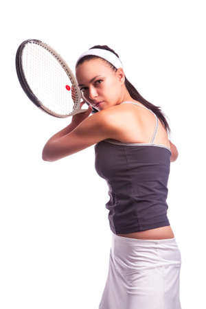 Sport Ideas. Portrait of Aggressive Caucasian Female Tennis Player in Sport Outfit Posing With Racket Against White. Vertical Image Composition Reklamní fotografie - 140352518