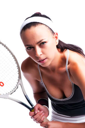Sport Ideas. Portrait of Aggressive Caucasian Female Tennis Player in Sport Outfit Posing With Racket Against White. Vertical Image Orientation Reklamní fotografie - 140352719