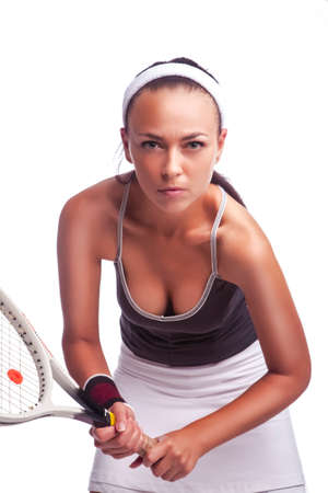 Sport Ideas. Portrait of Sexy Female Tennis Player in Sport Outfit Posing With Racket Against White. Vertical Image
