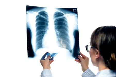 Medicine and Healthcare. Confident Professional Radiologist Doctor Checking Patient Xray Film On Screen Against White. Horizontal Image Composition
