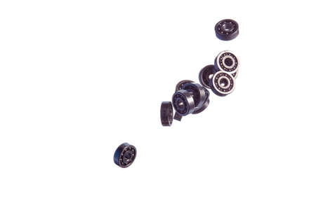 Large Amount of Ball Bearings Falling in Bulk Isolated Over Wgite Background. Horizontal Image Composition