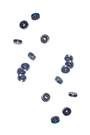 Large Amount of Ball Bearings Shaped and Formed In Free Fall Bulk. Isolated Over White Background. Vertical Composition