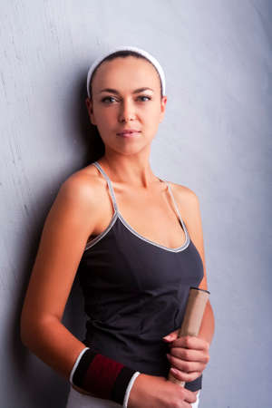 Sport Concepts. Caucasian Female Tennis Player in Sport Outfit Posing With Racket Indoors.Vertical Image Reklamní fotografie