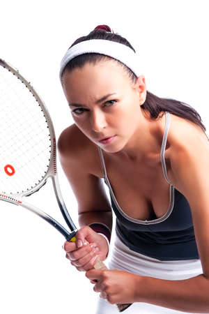 Sport Ideas. Portrait of Sexy Female Tennis Player in Sport Outfit Posing With Racket Against White. Vertical Image Orientation