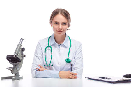 Portraif of Positive Caucasian Laboratory Researcher in Smock Working With Microscope While Conducting a Research.Horizontal Image Standard-Bild