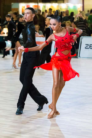 Riga, Latvia-December 15, 2019: Professional Adult Dance Couple Performs Youth Latin-American Program on the WDSF Baltic Grand Prix-2109 Championship in December 15, 2019 in Riga, Latvia