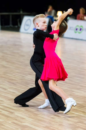 Riga, Latvia-December 15, 2019: Professional Adult Dance Couple Performs Juvenile Latin-American Program on the WDSF Baltic Grand Prix-2109 Championship in December 15, 2019 in Riga, Latvia