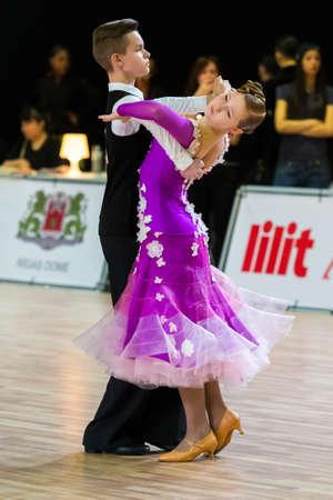 Riga, Latvia-December 15, 2019: Professional Adult Dance Couple Performs Juvenile European Standard Program on the WDSF Baltic Grand Prix-2109 Championship in December 15, 2019 in Riga, Latvia