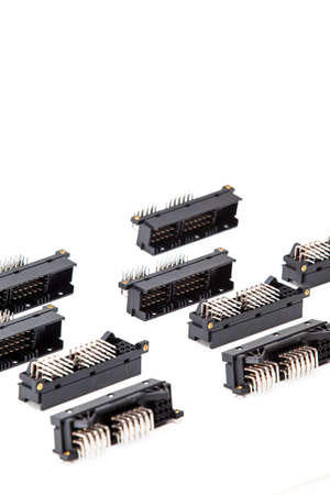 Electronic Components Concepts. Closeup of Rows of Long Angular PCB Connectors or Terminal Blocks Placed in Lines On White Background.Vertical Shot