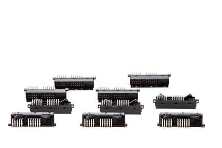 Electronic Components Concepts. Closeup of Rows of Long Angular PCB Connectors or Terminal Blocks Placed in Lines On White Background.Horizontal Shot