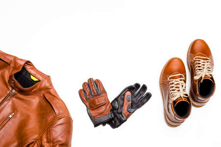 Motorcyclist Ideas. Set of Protective Motorcycling Clothing Consisting of Leather Jacket, Leather Tan Boots and Stitched Gloves. Horizontal image Фото со стока