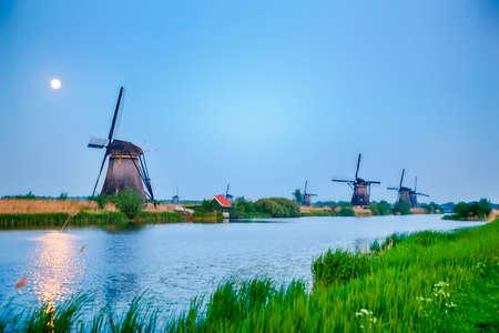 European Destinations. Traditional Romantic Dutch Windmills in Kinderdijk Village in the Netherlands. Horizontal Shot