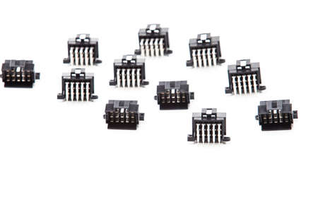 Electronic Components Concepts. Closeup of Rows of Short Angular PCB Connectors or Terminal Blocks Placed in Lines On White. Horizontal Shot