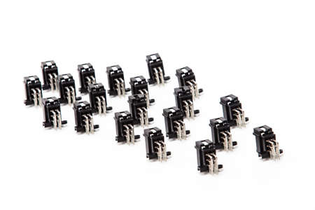 Electronic Components Ideas. Closeup of Rows of Angular PCB Connectors or Terminal Blocks Placed in Lines On White. Horizontal Image Banco de Imagens