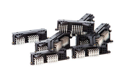 Electronic Components Concepts. Closeup of Rows of Long Angular PCB Connectors or Terminal Blocks Placed Randomly On White Background.Horizontal image Banco de Imagens - 147444355