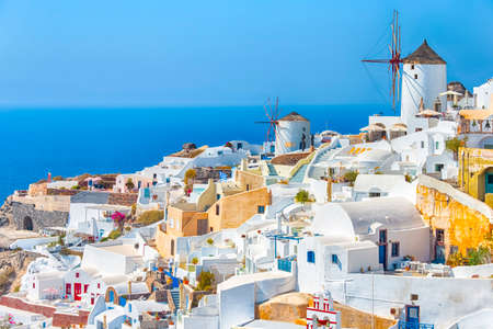 Greece Traveling. View of Greek Traditional Colorful Houses and Windmills of Oia or Ia at Santorini Island in Greece at Daytime. Horizontal Image Фото со стока