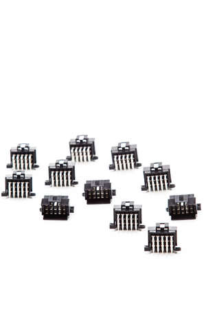 Electronic Components Concepts. Closeup of Rows of Short Angular PCB Connectors or Terminal Blocks Placed in Lines On White Background. Vertical Composition