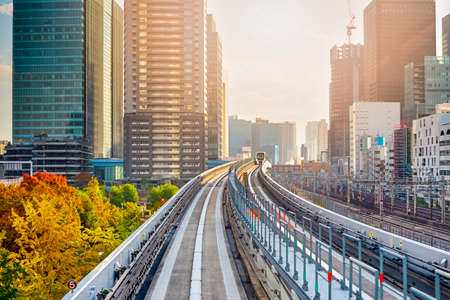 Japanese Destinations. Distant Monorail Train Approaching to Station In Tokyo City in Japan.Horizontal Image Orientation