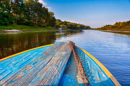 Belarussian Travel Destinations. The Pripyat River with Motorboat Passing Along the Shore. Horizontal Shoot