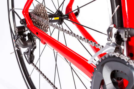 Cycling Ideas. Closeup of Crankset and Rear Cassette with New Chain. Against White. Horizontal Image