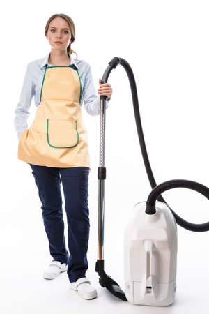 Caucasian Woman With Vacuum Cleaner In Protective Clothing Against White. Vertical Image