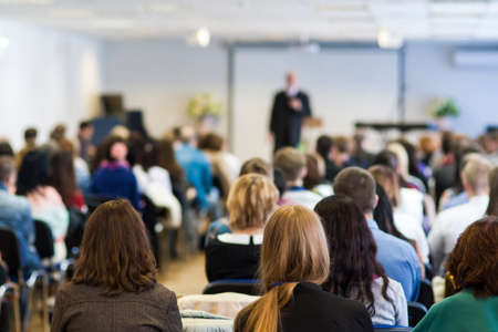 Professional Male Lecturer Speaking In Front of the Group of People. Horizontal Image Composition Stockfoto