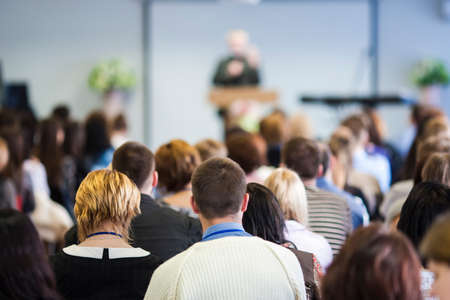 Conferences Concept. Male Lecturer Speaking In Front of the Audience During The Conference. Horizontal Image Imagens