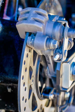 Closeup of Modern Motorcycle Front Brake System. Vertical image Composition